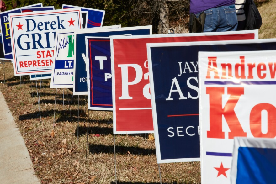 Campaign signs line the sidewalk outside a St. Louis County polling site at the Ballwin Golf Course and Events Center on Election Day Tuesday, November 3, 2020.