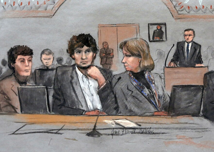 In this March 5, 2015 file courtroom sketch, Dzhokhar Tsarnaev, center, is depicted between defense attorneys Miriam Conrad, left, and Judy Clarke, right, during his federal death penalty trial in Boston.