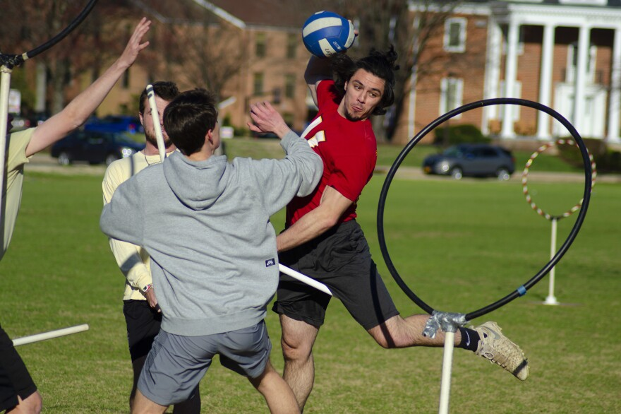 Quidditch is a fast-paced, co-ed, full-contact combination of dodgeball, rugby and basketball. Above, John Sheridan tries to score points by throwing a quaffle ball through the other team's hoop.
