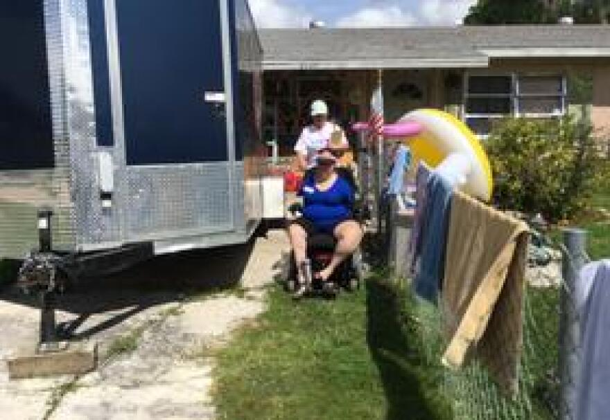 """Olivia Babis and her """"canvassing buddy"""" struggle to get her wheelchair to knock on front doors"""