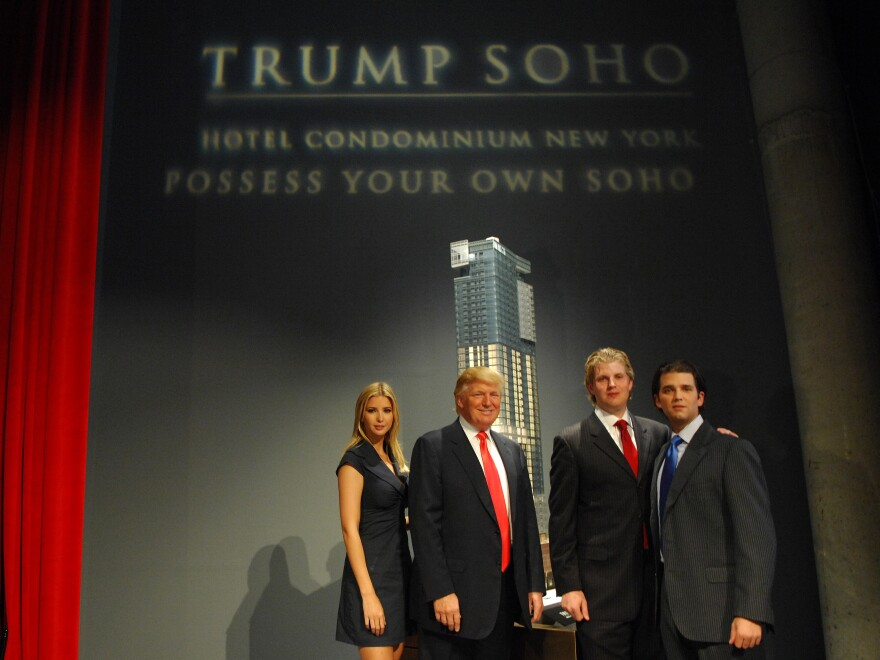 Ivanka Trump, Donald Trump, Eric Trump and Donald Trump Jr. stand before the rendering of the under-construction Trump SoHo Hotel Condominium in September 2007.