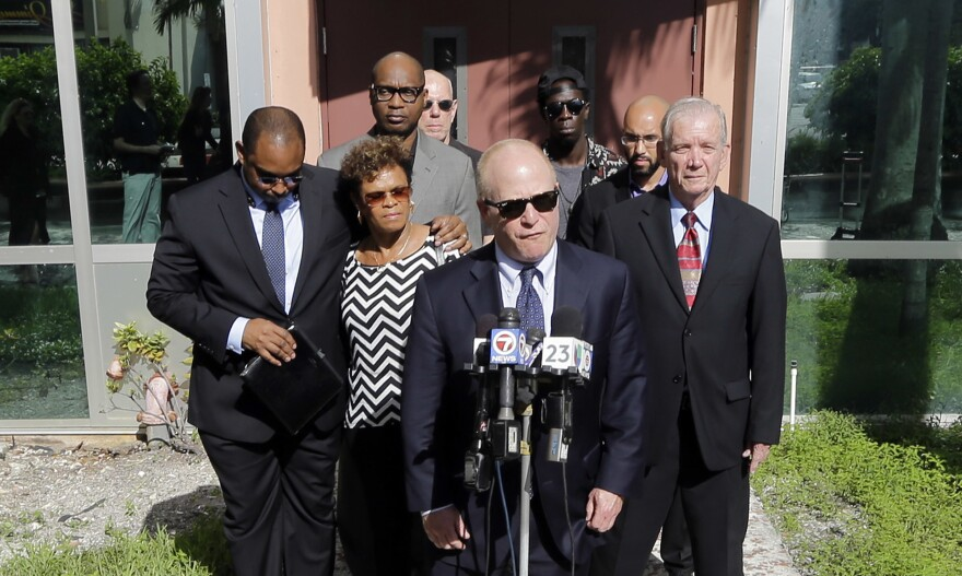 Attorney David Schoen (center) talks to reporters during a news conference in 2015 with the family of Jermaine McBean, who was shot and killed by a sheriff's deputy while carrying an air rifle, in Fort Lauderdale, Fla.