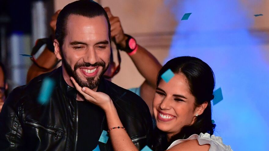 Nayib Bukele, celebrating with his wife, Gabriela Rodríguez de Bukele, was declared the winner of El Salvador's presidential election Sunday night.
