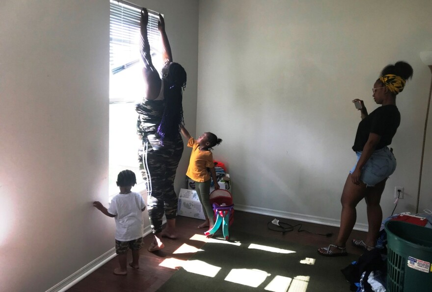 Brittany Ferrell takes video of Iyanna Graham at home, with two of Graham's three children standing close by.