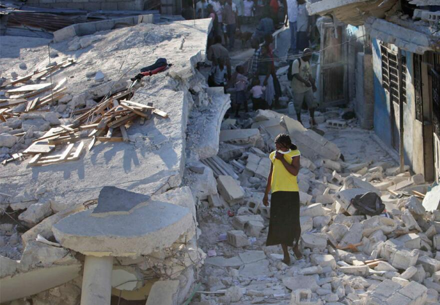 A woman wanders the rubble of her neighborhood in Port-au-Prince after the 2010 earthquake.