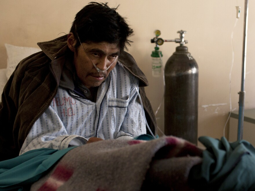 Saturnino Soncko, 58, has been inhaling the fine dust at the silver mines of Cerro Rico for years. He is now extremely ill, gasping for breath in the pulmonary wing of a public hospital in Potosi, Bolivia.