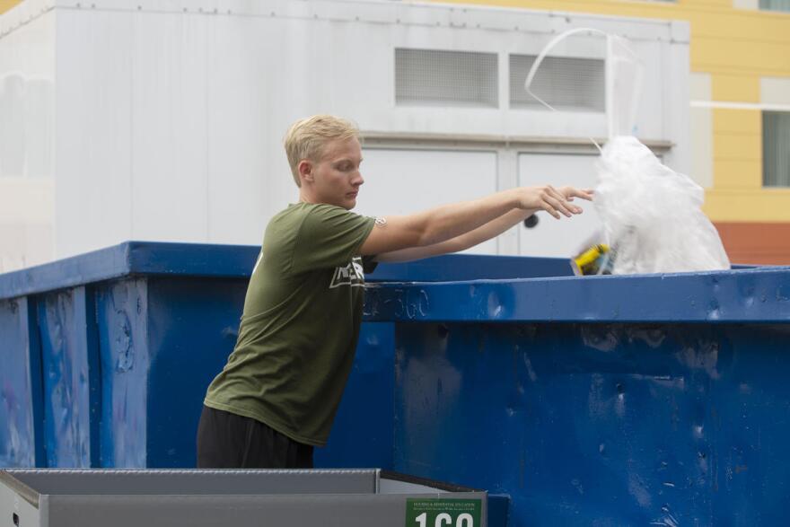 Matthew Williams throwing garbage away