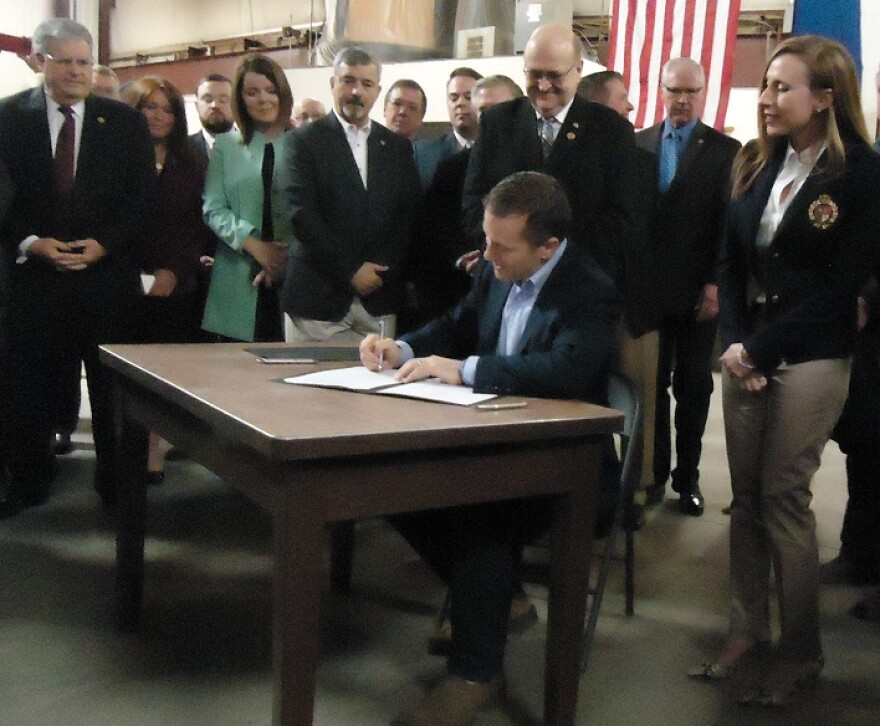 Gov. Eric Greitens signs legislation making Missouri the 28th right-to-work state at a ceremony Monday in Springfield. (Feb. 6, 2016)