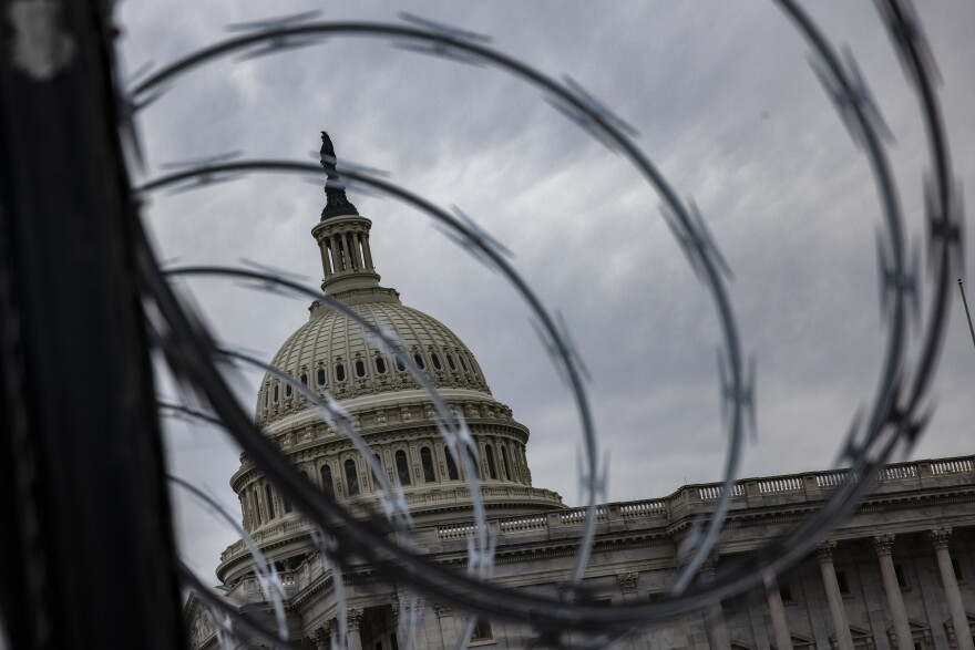 Razor wire is seen last week after being installed on the fence surrounding the grounds of the U.S. Capitol due to security threats.