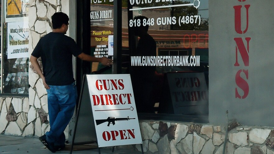 Gov. Jerry Brown signed six new bills into law Friday, nearly seven months after a mass shooting in San Bernardino, Calif. Two of the new laws restrict ammunition. In this photo from last summer, a man enters a gun store in Los Angeles.