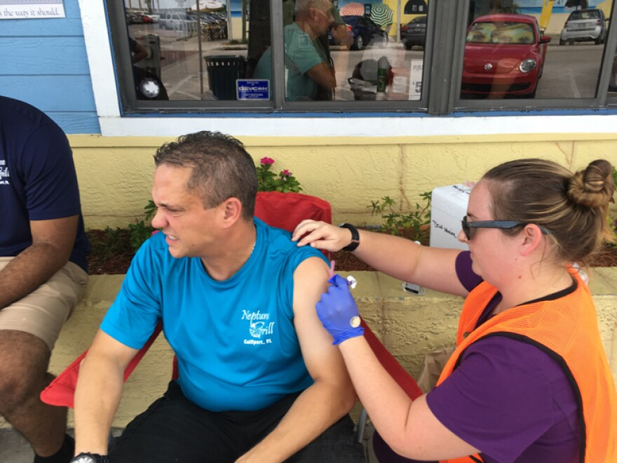 Michele Means, a nurse with the health department in Pinellas County, delivers a hepatitis A shot to a restaurant employee in Gulfport.