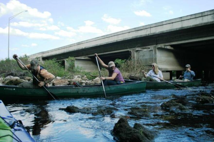 Expedition members on the rocks on Reedy Creek at I-4