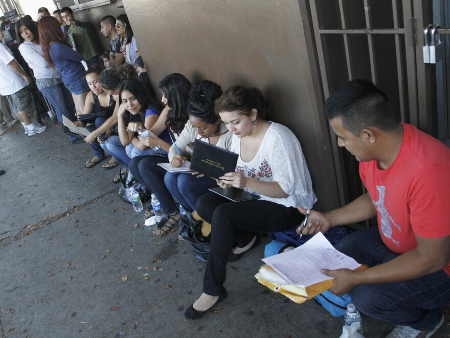Crowd members seek help applying for the Deferred Action for Childhood Arrivals program at the Coalition for Humane Immigrant Rights of Los Angeles last August.