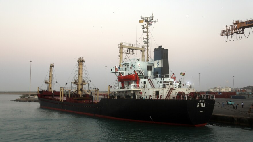 A ship carrying food aid docks at the port of the Yemeni coastal city of Hodeidah on Sunday.