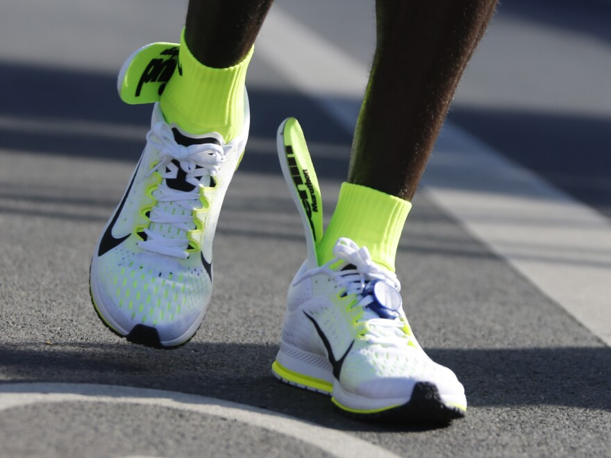 The insoles of Kenya's Eliud Kipchoge's running shoes are seen slipping up to his ankles, after he crosses the finish line to win the men's 42nd Berlin marathon on Sunday. He won the race, but missed the world record by 63 seconds.