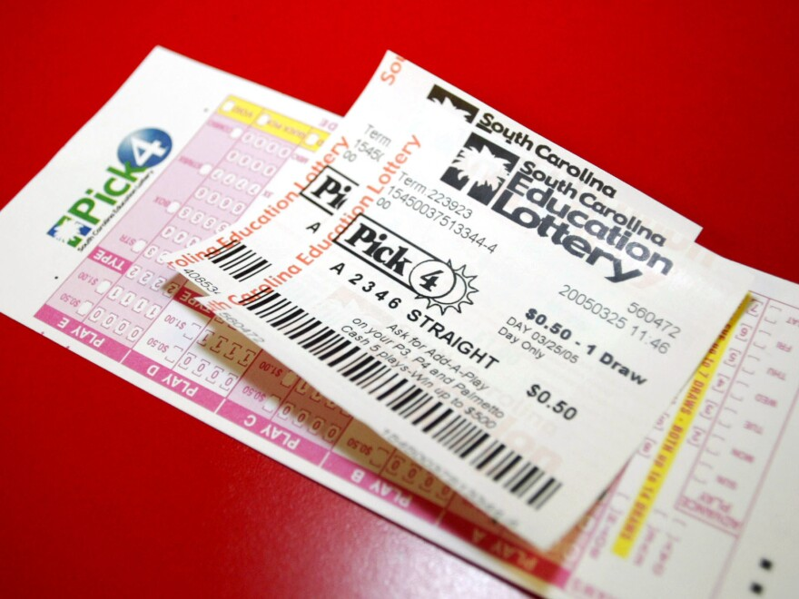The South Carolina Education Lottery says a programming error in its computer system vendor is to blame for a profusion of winning tickets on Christmas. Two of the state's lottery tickets are pictured here in 2005.