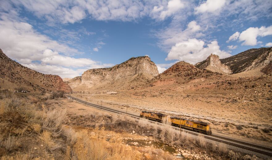 A shot of a train passing through Utah. Recently a shipment of nuclear waste was sent via rail from Tennessee to southern Nevada, passing through Utah.