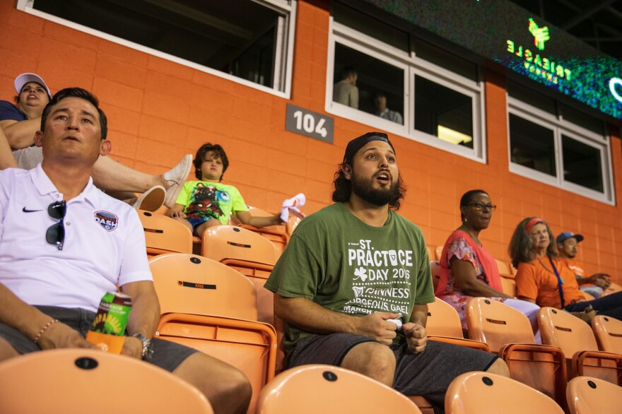 Marco Gomez, 30, watches the match. He says a call to support women's soccer on Instagram is what got him coming to this game.