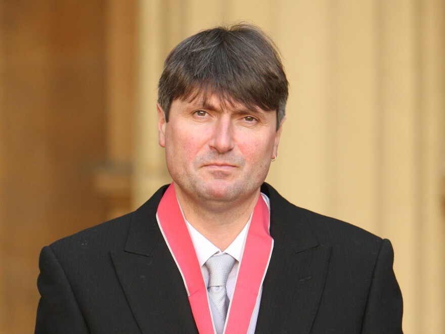 Simon Armitage frowns with dignity after being awarded the Commander of the British Empire medal at Buckingham Palace in 2010. Though he began the nomination process for the Oxford post as an underdog, he emerged from the ensuing drama with the professorship.