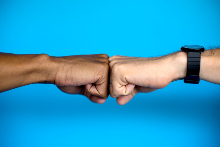 One set of knuckles meets another. Both are equal in this greeting that expresses approval and triumph.