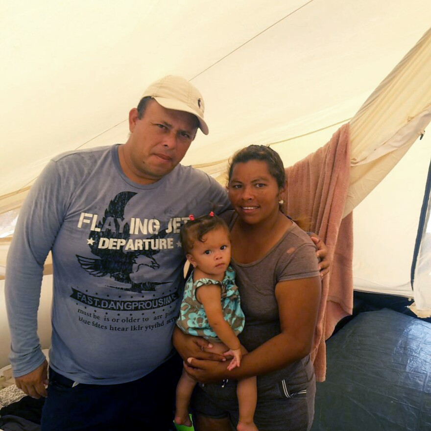 Eric Godoy had been living on the streets of Maicao with his wife and 1-year-old daughter before coming to the tent camp. Now he works at an outdoor market in Maicao and says he can now save his money because he doesn't pay for food at the U.N. camp.