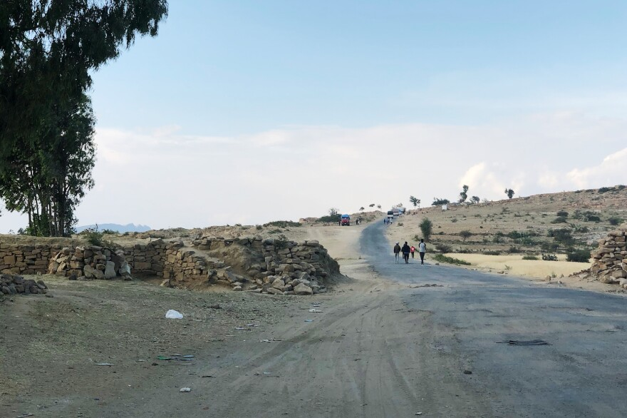 People walk on a road that leads from Ethiopia into Eritrea. The two countries' border was opened in September, the first time in nearly 20 years.