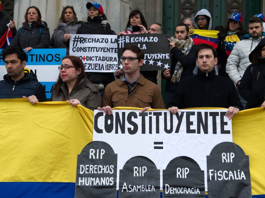 Members of Argentina's Venezuelan community protest against the election for a constituent assembly on Sunday, in Buenos Aires, as Venezuela holds the controversial vote.