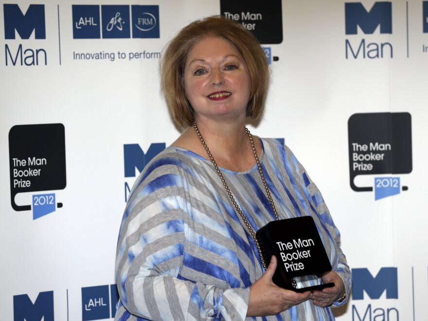 Hilary Mantel, winner of the Man Booker Prize for Fiction, poses with her prize shortly after the award ceremony in London Tuesday. Mantel, won the 50,000 British pounds (approximately $80,000) prize with her book <em>Bring up the Bodies</em>.
