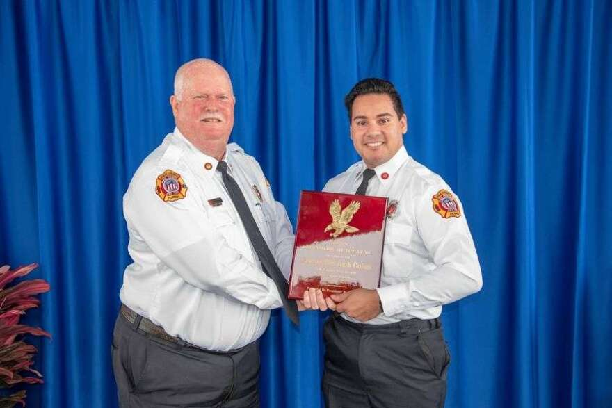 Joshua Colon, shown on the right, was recognized as Polk County's 2020 Firefighter of the Year. Photo: PCFR via Facebook