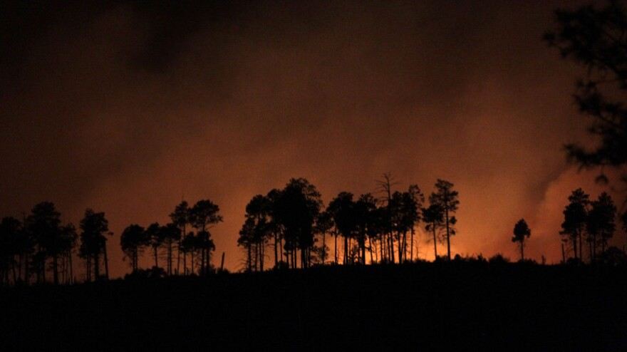 Flames light the sky near Los Alamos, N.M., early Tuesday, (June 28, 2011).