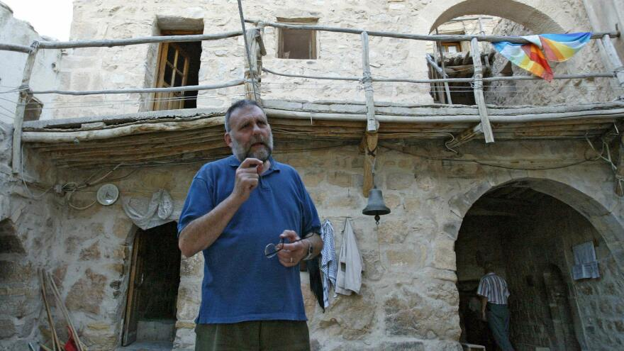 The Italian Jesuit priest Paolo Dall'Oglio, shown here at the Syrian Maronite monastery of Deir Mar Musa in 2007, lived in Syria for 30 years before he was expelled Saturday. Dall'Oglio has spoken out in support of protesters who oppose President Bashar Assad.