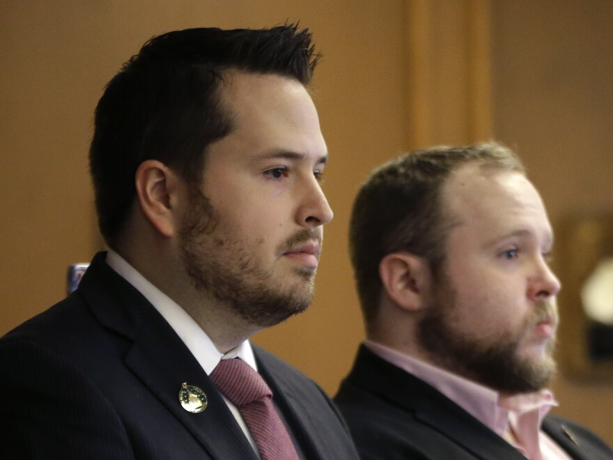 New Hampshire state Rep. Robert Fisher (left) attends a public hearing this week. Fisher says reports of alleged comments he made online degrading women were taken out of context.