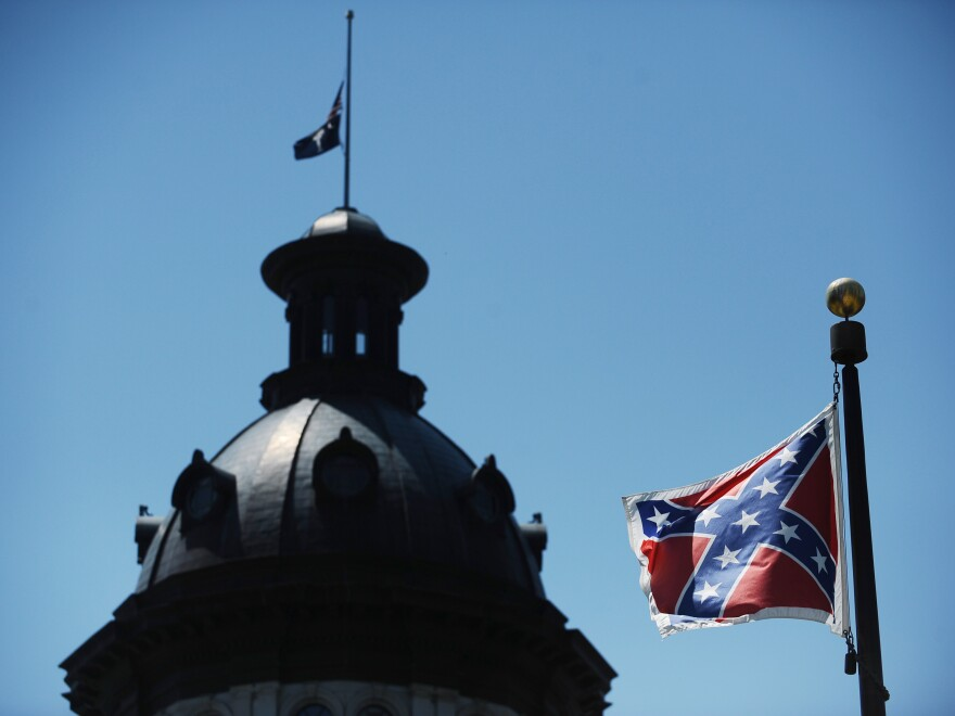 The Confederate flag flies near the South Carolina Statehouse, Friday, June 19, 2015, in Columbia, S.C. Tensions over the Confederate flag flying in the shadow of South Carolina's Capitol rose this week in the wake of the killings of nine people at a black church in Charleston, S.C.