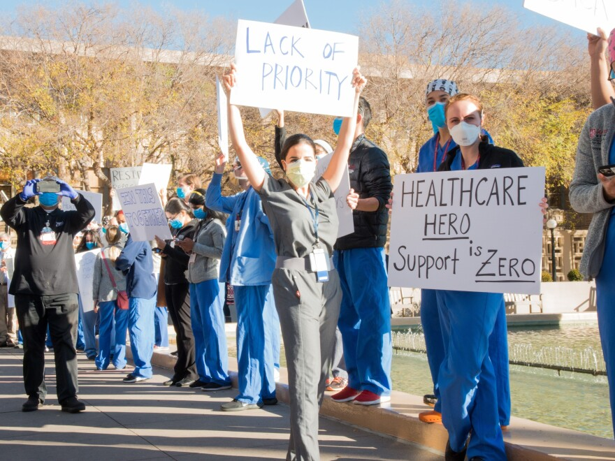 Medical residents and fellows protest the university's vaccine allocation process outside Stanford Hospital on Friday morning in Palo Alto, Calif.