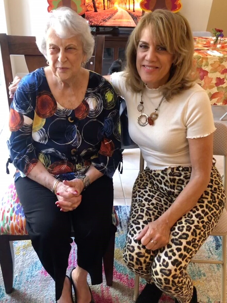 Diane McMillen sits with her mother Joanne, who lives in an assisted living facility in Tampa.
