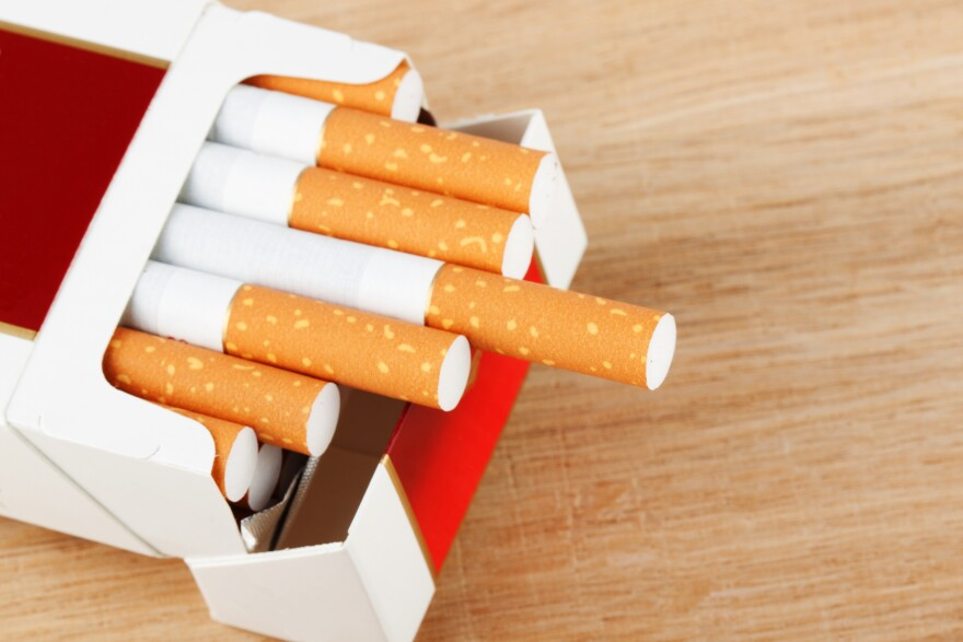 Several Cigarettes in pack on the breadboard