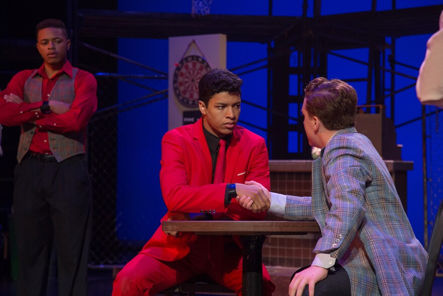 """COCA's community production of """"West Side Story"""" features a cast of actors 21 including Nathanael Hirst as Bernardo, seen wearing a red suit."""