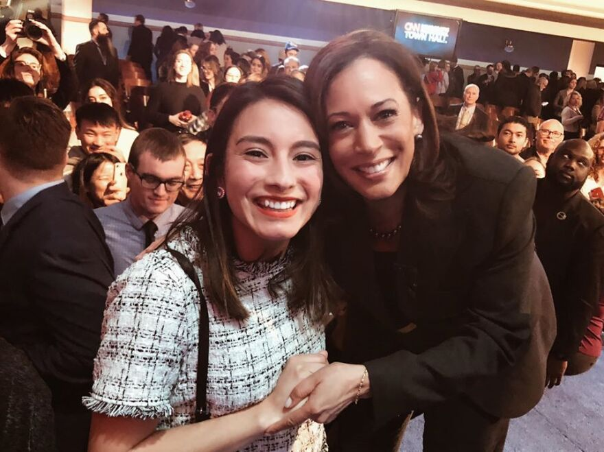 A young woman, Lilián Sánchez, holds hands with Sen. Kamala Harris, D-CA.