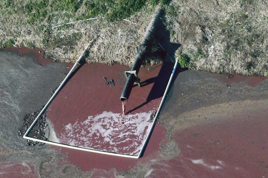 A hog facility in Duplin County, N.C. discharges waste into a manure lagoon, April 2015.