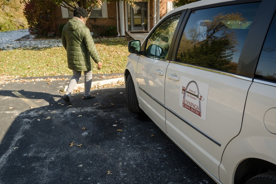 Jennings School District social workers prepare a recently purchased minivan Nov. 14, 2019. The district is using vans to transport homeless students, which has cut costs and improved attendance compared to paying for taxi cabs.