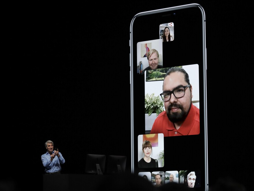An Apple executive talks about group FaceTime during an announcement of new products at the Apple Worldwide Developers Conference in June. Apple says it has disabled group FaceTime after a bug was revealed letting callers eavesdrop on recipients before they accepted a call.