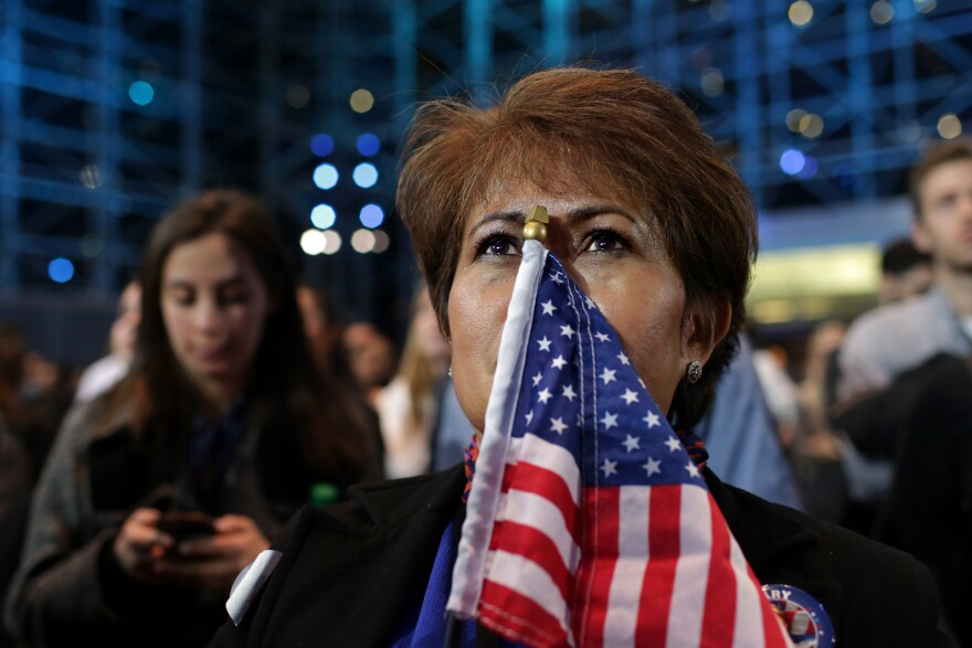 "Teary-eyed Rebecca Canalija, 57, waits for Democratic presidential nominee Hillary Clinton to address the crowd in New York City on Tuesday. Canalija called Donald Trump's win ""tragic"" and said she is feeling depressed over it."