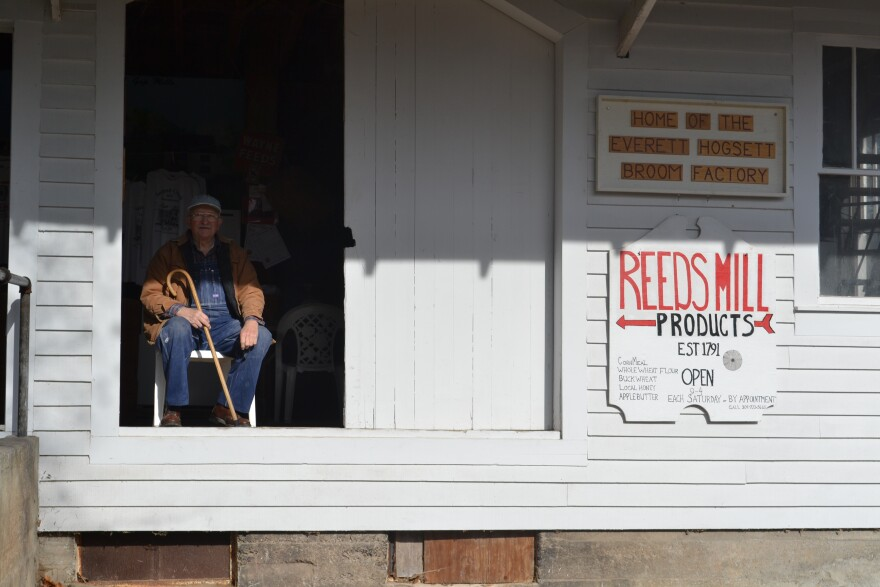 Larry Mustain sits at the Reeds Mill Grist House