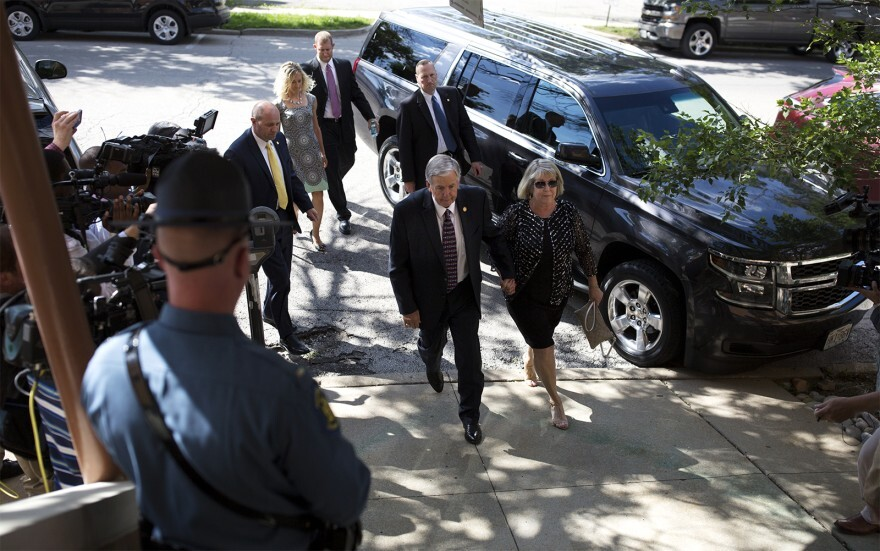 Missouri Gov. Mike Parson (center) and First Lady Teresa Parson (right), seen in this June 2018 photograph, tested positive for the coronavirus on Wednesday.