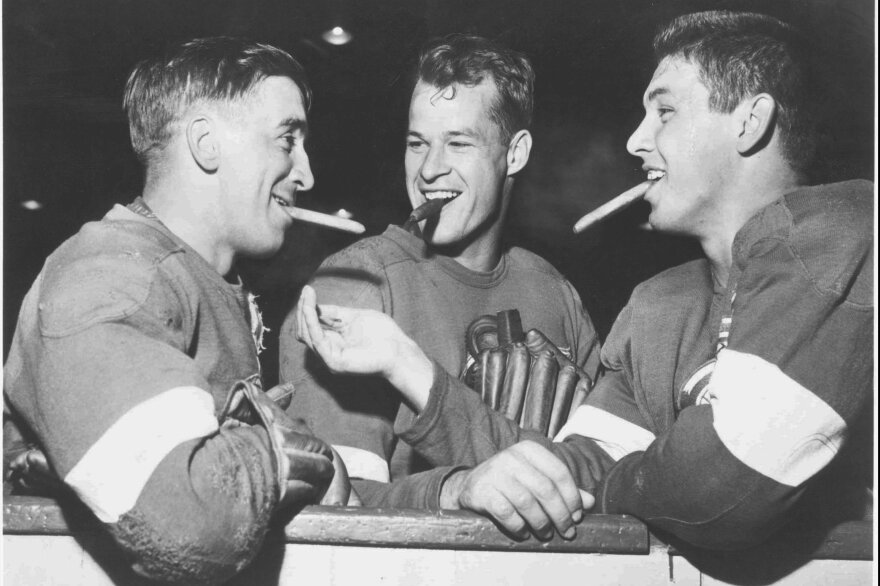 Gordie Howe (center) spent most of his career with the Detroit Red Wings, leading the team to four Stanley Cup championships. He finished his pro hockey career with 1,071 goals and 21 NHL All-Star appearances.
