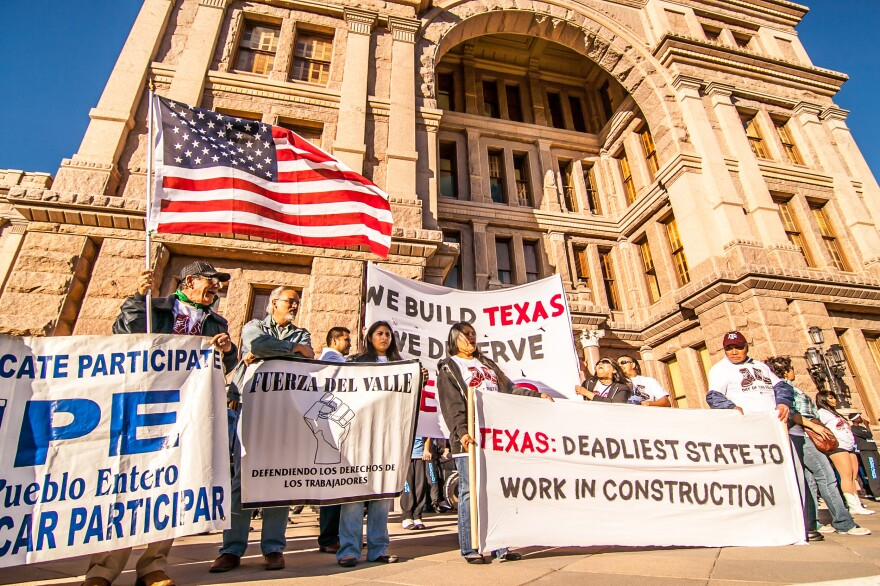 Marchers at the state capitol building in Austin, Texas, in February protest working conditions in the state's construction sector.