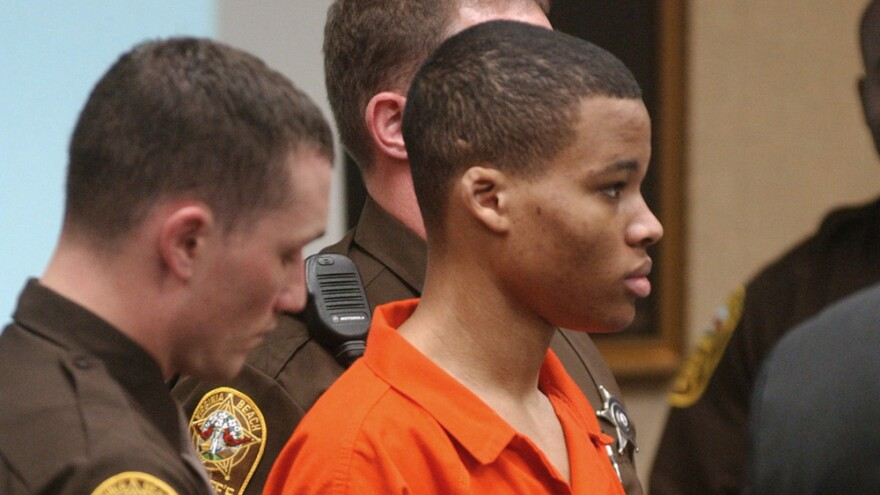 Lee Boyd Malvo, pictured in 2003, listens to court proceedings during the trial of fellow sniper suspect John Allen Muhammad in Virginia Beach, Va.
