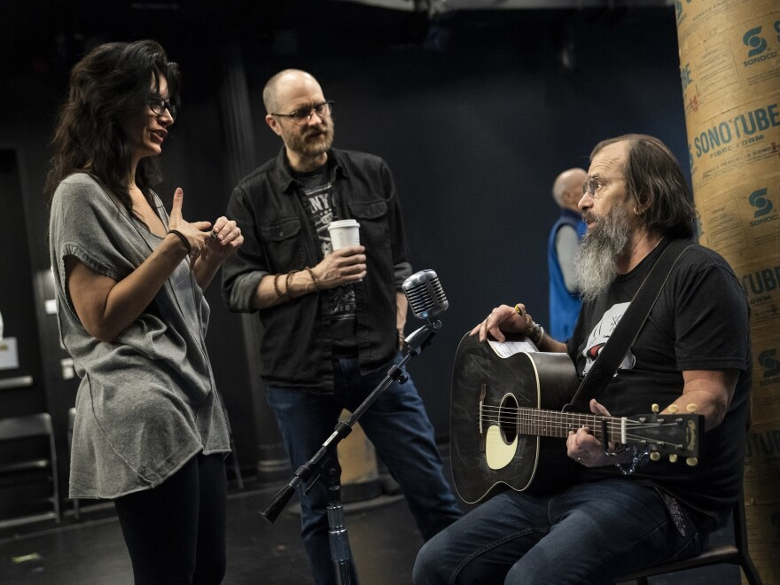 Playwrights Jessica Blank and Erik Jensen talk with Steve Earle during rehearsals.