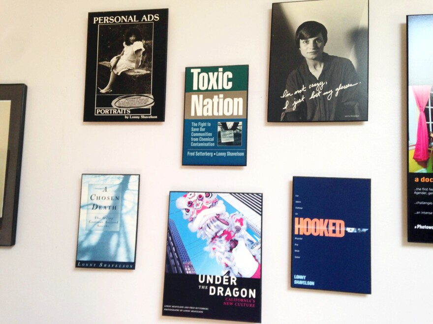 Copies of the covers of Shavelson's books decorate his office wall.