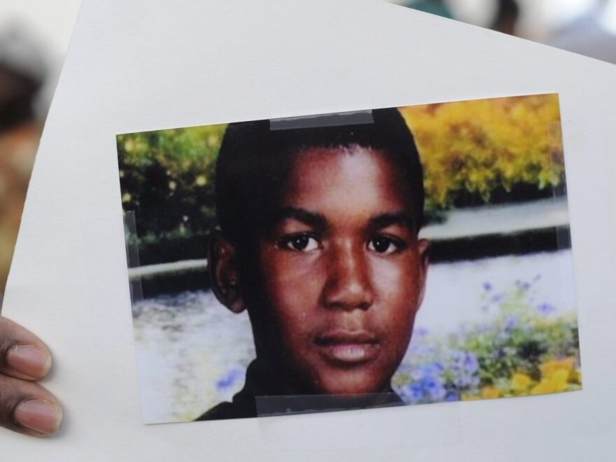 This photo of Trayvon Martin was held by a supporter during a recent rally in the Goldsboro neighborhood of Sanford, Fla.